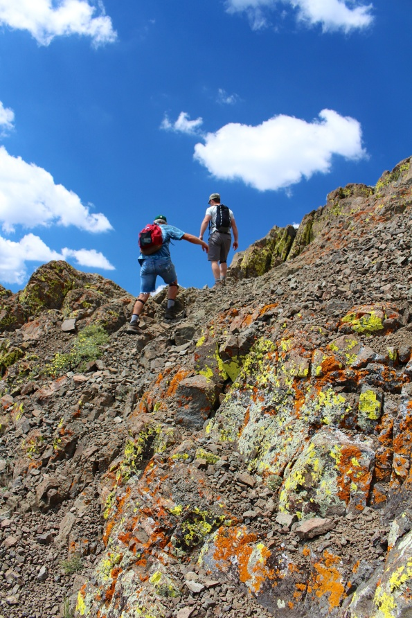Scrambling up the lichen-crusted rocks